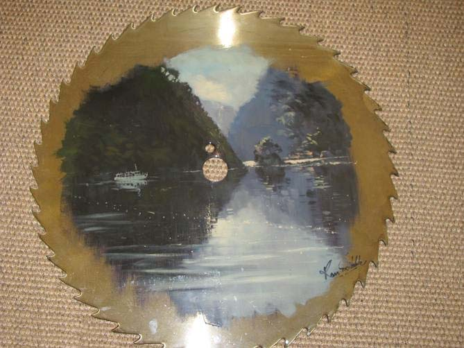 Painting by Ron Gribble on a skill saw blade